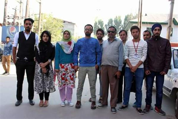 Guard of justice and humans rights kashmir held silent protest at press colony Srinagar on braid chopping | KNO