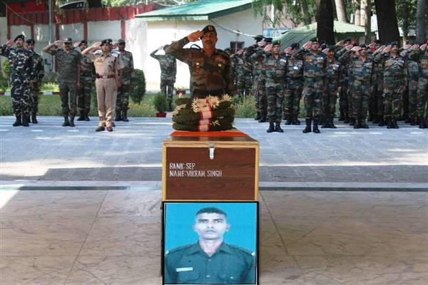 Army Pays Tribute to Slain Soldier | KNO